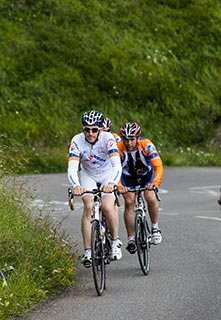 cyclists touring on winding road